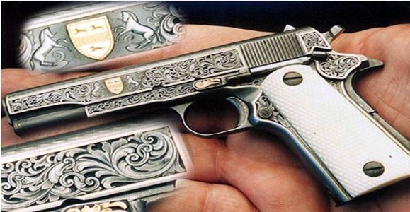 Гравировка по металу на пистолете.